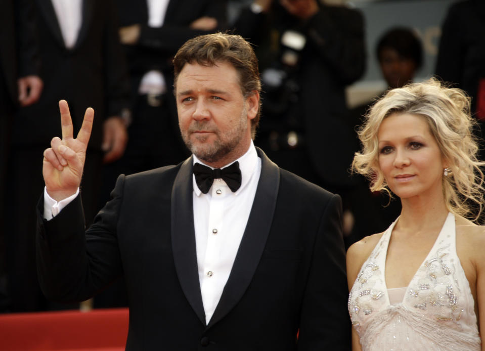 """Actor Russell Crowe, left, and Danielle Spencer attend the premiere for the film """"Robin Hood"""", at the 63rd international film festival, in Cannes, southern France, Wednesday, May 12, 2010. (AP Photo/Joel Ryan)"""