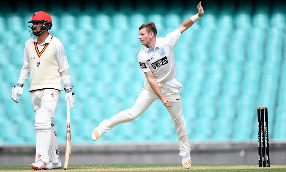 Mason Crane bowling for New South Wales