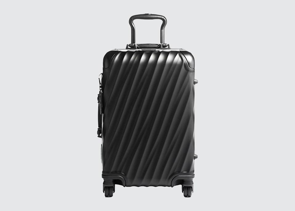 "<p>""I love the Tumi carry-on, the largest model—it expands or shrinks, depending. There's also the <a href=""https://fave.co/2UbAhYo"" rel=""nofollow noopener"" target=""_blank"" data-ylk=""slk:Rimowa aluminum"" class=""link rapid-noclick-resp"">Rimowa aluminum</a>, which I love. It's the trunk suitcase on wheels."" <em>—</em><a href=""https://www.cntraveler.com/contributors/mary-jean-tully?mbid=synd_yahoo_rss"" rel=""nofollow noopener"" target=""_blank"" data-ylk=""slk:Mary Jean Tully"" class=""link rapid-noclick-resp""><em>Mary Jean Tully</em></a><em>, founder and CEO, Tully Luxury Travel</em></p> <p><strong>Shop now:</strong> <a href=""https://fave.co/2AeftbA"" rel=""nofollow noopener"" target=""_blank"" data-ylk=""slk:tumi.com"" class=""link rapid-noclick-resp"">tumi.com</a></p>"