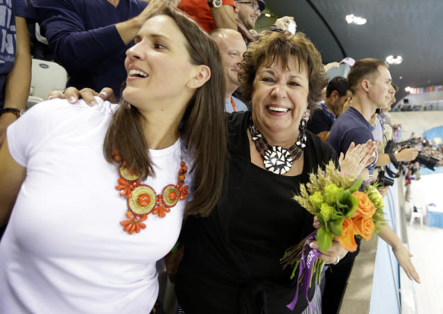 Debbie Phelps, mother of United States swimmer Michael Phelps, and her daughter Hilary smile after Phelps' team won the gold medal un the men's 4 x 200-meter freestyle relay at the Aquatics Centre in the Olympic Park during the 2012 Summer Olympics in London, Tuesday, July 31, 2012. (AP Photo/Lee Jin-man)
