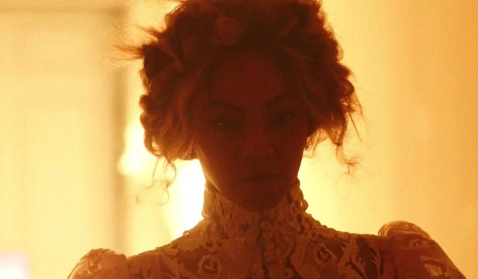 <p>Lace up the neck + pinned updo conjure up a throwback time in New Orleans.</p>
