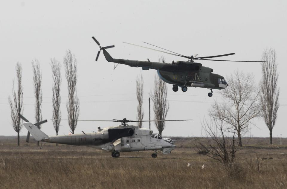 Helicopters are seen during a military drill conducted by Ukrainian servicemen near the city of Mykolaiv, also known as Nikolayev, in southern Ukraine, northwest of the Crimean peninsula March 14, 2014. REUTERS/Valentyn Ogirenko