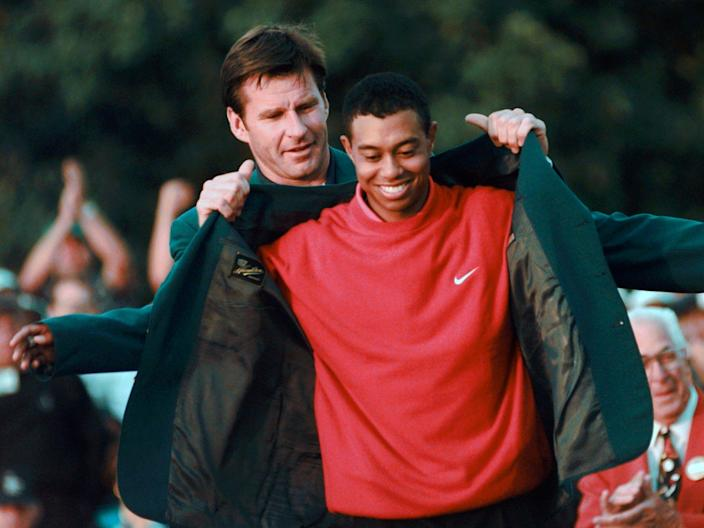 FILE - In this April 13, 1997, file photo, Masters champion Tiger Woods receives his Green Jacket from last year's winner Nick Faldo, left, at the Augusta National Golf Club in Augusta, Ga. ``Phenomenal performance,″ Nick Faldo, last year's winner, told Woods. ``Welcome to the green jacket.″ (AP Photo/ Dave Martin, File)