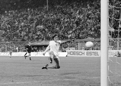 FILE - In this July 3, 1974 file photo, Netherlands forward Johann Cruyff scores his team's second goal against Brazil in their World Cup soccer match in Dortmund, West Germany. The Netherlands beats Brazil 2-0 to qualify for the World Cup final, where it lost 2-1 despite going ahead. The 21st World Cup begins on Thursday, June 14, 2018, when host Russia takes on Saudi Arabia. (AP Photo, File)