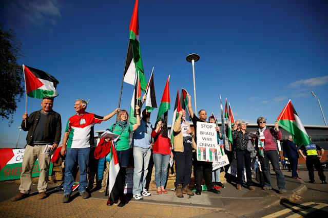 Soccer Football - UEFA European Under-17 Championship - Group A - England v Israel - Proact Stadium, Chesterfield, Britain - May 4, 2018 Protesters with Palestinian flags outside the stadium before the match Action Images via Reuters/Jason Cairnduff