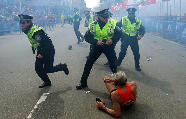 Boston police officers react to the Marathon bombings (John Tlumacki / AP)