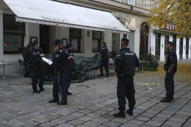 Police officers guard the crime scene at a restaurant in Vienna, Austria