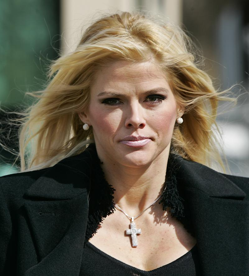 FILE - In this Feb. 28, 2006, file photo, Anna Nicole Smith, leaves the U.S. Supreme Court in Washington. The Supreme Court is preparing to hear arguments on whether Anna Nicole Smith's estate should get part of the fortune left behind by her elderly Texas billionaire husband. Lawyers for the deceased former Playmate plan to tell justices Tuesday, Jan. 18, 2011, her estate deserves some of the $1.6 billion estate of her late husband, J. Howard Marshall. (AP Photo/Manuel Balce Ceneta, File)