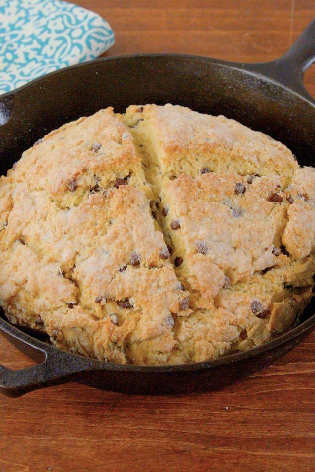 """<p>This bread is an amped up take on traditional Irish soda bread. It's got mini chocolate chips and can be served in a skillet with melted chocolate if you want to make it extra sweet. </p><p><strong><em>Get the recipe at <a href=""""https://www.delish.com/cooking/recipe-ideas/recipes/a51728/irish-soda-bread-recipe/"""" rel=""""nofollow noopener"""" target=""""_blank"""" data-ylk=""""slk:Delish"""" class=""""link rapid-noclick-resp"""">Delish</a>. </em></strong></p>"""