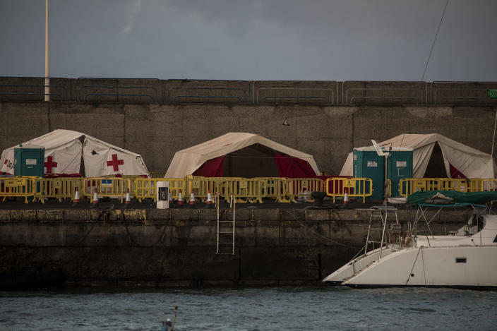 """A view of the now empty makeshift migrant camp located at the Arguineguin port on the southwestern coast of the Gran Canaria island, Spain on Monday Nov. 30, 2020. Spain has dismantled most of the temporary camp for migrant processing that for over three months became known as the """"dock of shame"""" for holding in unfit conditions thousands of Africans arriving lately in the Canary Islands. (AP Photo/Javier Fergo)"""