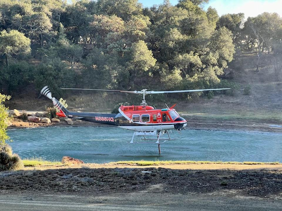 A helicopter snorkels up water on the Reagan Ranch - Credit: Andrew Coffin/YAF