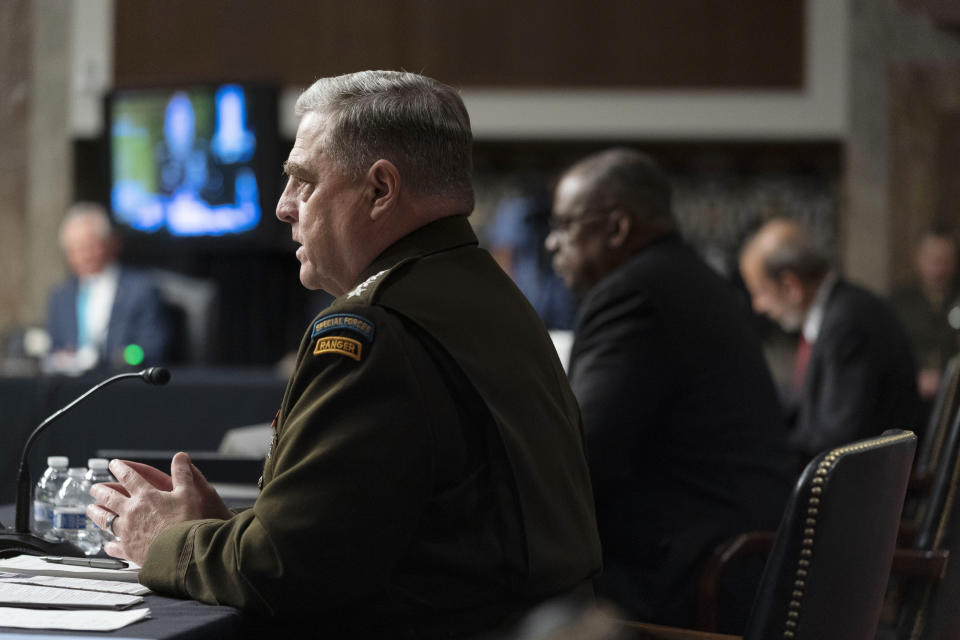 From left, Chairman of the Joint Chiefs of Staff Gen. Mark Milley, accompanied by Secretary of Defense Lloyd Austin, and Defense Under Secretary Mike McCord, speaks at a Senate Armed Services budget hearing on Capitol Hill in Washington, Thursday, June 10, 2021. (AP Photo/Andrew Harnik)