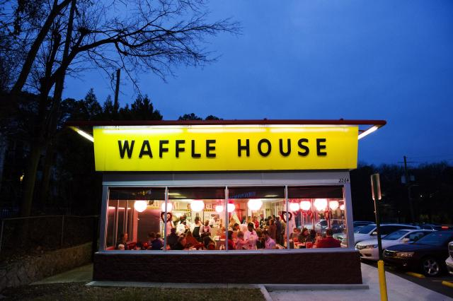 Diners eat at a Waffle House restaurant decorated for Valentine's Day in Atlanta, Wednesday, Feb. 14, 2018. (AP Photo/David Goldman)