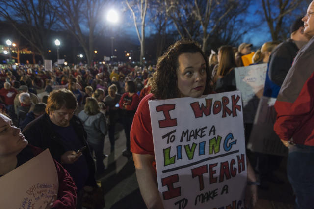 <p>Annie Hancock, a teacher from Jackson County, holds her sign outside of the capitol building after WVEA President Dale Lee outlined the terms for ending the walkout on the fourth day of statewide walkouts in Charleston, W.Va., on Tuesday, Feb. 27, 2018. (Photo: Craig Hudson/Charleston Gazette-Mail via AP) </p>