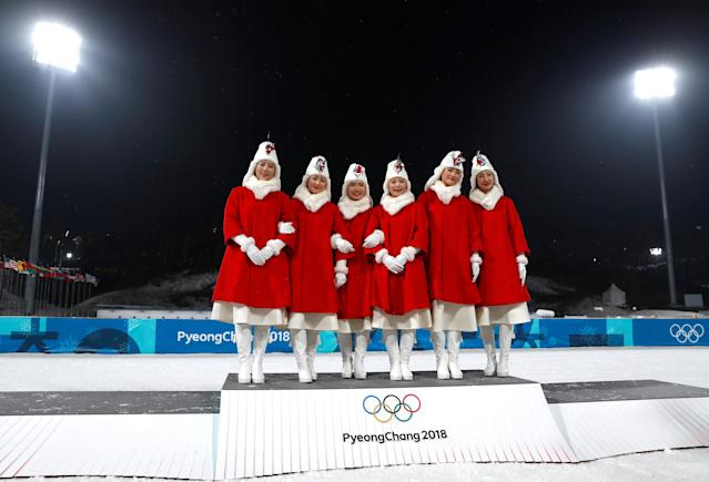 Hostesses pose on the podium at the end of the biathlon competitions at the Alpensia Biathlon Centre in Pyeongchang, South Korea February 23, 2018. REUTERS/Murad Sezer