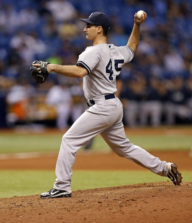 New York Yankees infielder Dean Anna makes an appearance as a relief pitcher during the eighth inning of a baseball game against the Tampa Bay Rays, Saturday, April 19, 2014, in St. Petersburg, Fla. The Rays won 16-1. (AP Photo/Mike Carlson)
