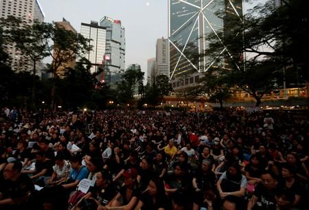 People attend a rally in support of demonstrators protesting against proposed extradition bill with China, in Hong Kong