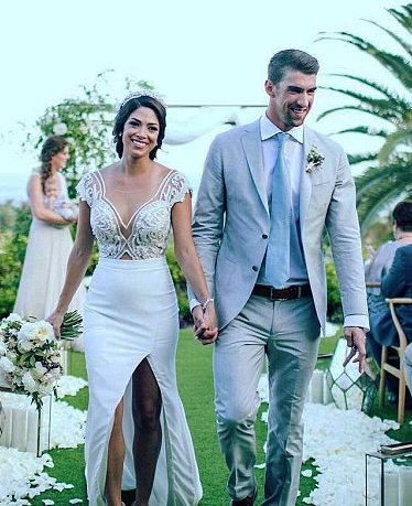 """<p>Olympian <a href=""""https://www.brides.com/story/michael-phelps-wedding-video"""" rel=""""nofollow noopener"""" target=""""_blank"""" data-ylk=""""slk:Michael Phelps married"""" class=""""link rapid-noclick-resp"""">Michael Phelps married</a> 2010's Miss California USA Nicole Johnson on June 13, 2016 in an intimate five-person ceremony in their backyard in Arizona. They have one son together named Boomer. </p>"""