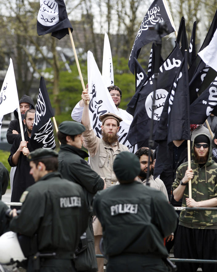 Police control a demonstration of Salafists in Solingen northwestern Germany, Tuesday, May 1, 2012. They protested against the right-wing movement Pro NRW who presented controversial Islam cartoons during may day celebrations. (AP Photo/dapd, Roberto Pfeil)