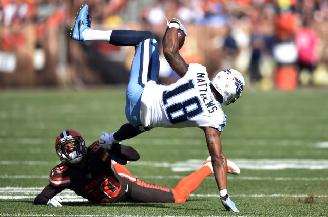 <p>Cleveland Browns strong safety Briean Boddy-Calhoun (20) up-ends Tennessee Titans wide receiver Rishard Matthews (18) in the first half of an NFL football game, Sunday, Oct. 22, 2017, in Cleveland. (AP Photo/David Richard) </p>