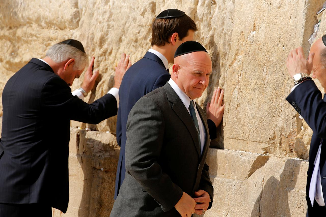 White House National Security Advisor H.R. McMaster (C) turns to depart after he and U.S. Secretary of State Rex Tillerson (L), White House senior advisor Jared Kushner (2nd L) and chief economic advisor Gary Cohn (R) leave notes at the Western Wall in Jerusalem May 22, 2017.  REUTERS/Jonathan Ernst