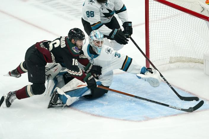 San Jose Sharks goaltender Martin Jones (31) stops a shot by Arizona Coyotes center Derick Brassard (16) during the first period of an NHL hockey game Saturday, Jan. 16, 2021, in Glendale, Ariz. (AP Photo/Ross D. Franklin)
