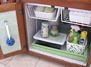 """<p>This utility zone might be hidden from guests, but <em>you</em> still have to look at it every day. <a href=""""https://www.goodhousekeeping.com/home/organizing/tips/g1653/under-the-sink-organizing/"""" rel=""""nofollow noopener"""" target=""""_blank"""" data-ylk=""""slk:Choose furniture-like pieces"""" class=""""link rapid-noclick-resp"""">Choose furniture-like pieces</a> (like this blogger's green drawer-turned-tray) and wrap the interior with patterned contact paper to inspire you to stay tidy.</p><p><a href=""""http://www.craftsalamode.com/2014/05/my-under-sink-makeover.html"""" rel=""""nofollow noopener"""" target=""""_blank"""" data-ylk=""""slk:See more at Crafts a la Mode »"""" class=""""link rapid-noclick-resp""""><em>See more at Crafts a la Mode »</em></a></p>"""