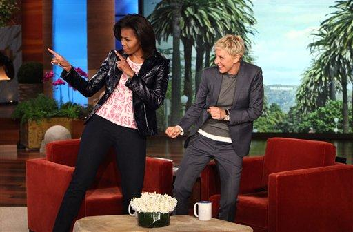 """In this photo released by Warner Bros., talk show host Ellen DeGeneres is shown with first lady Michelle Obama during a taping of """"The Ellen DeGeneres Show"""" on Wednesday, Feb. 1, 2012 in Burbank, Calif. This episode will air on Thursday, Feb. 2. (AP Photo/Warner Bros., Michael Rozman)"""