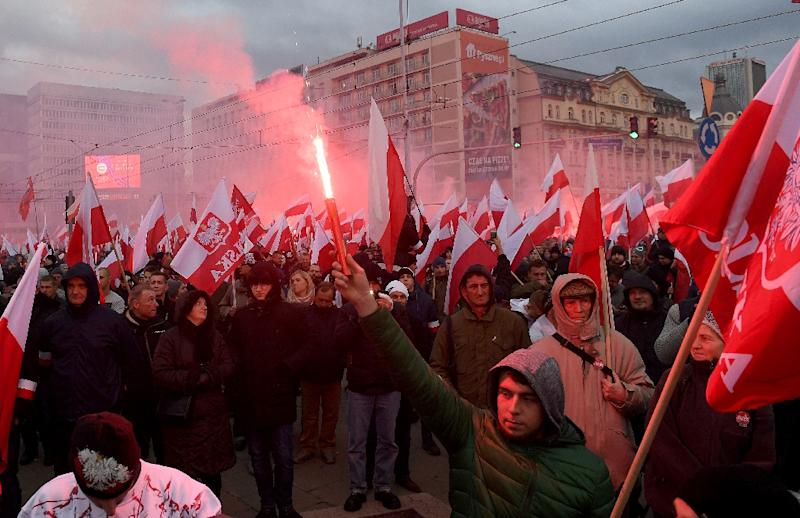Demonstrators burn flares and wave Polish flags during the annual march to commemorate Poland's National Independence Day in Warsaw organised by far-right groups on Saturday, which has led Polish leaders to speak out against xenophobia. (AFP Photo/JANEK SKARZYNSKI)