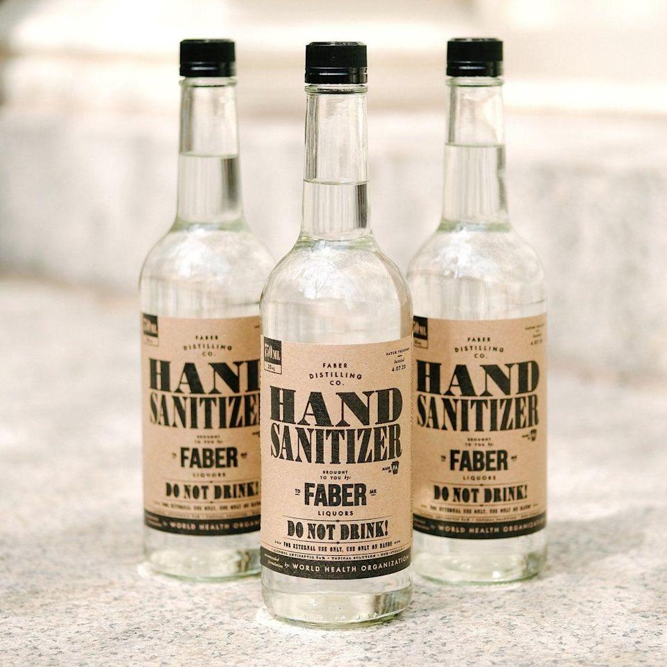 """<p><strong>Faber Distilling Co.</strong></p><p>artintheage.com</p><p><strong>$10.00</strong></p><p><a href=""""https://shop.artintheage.com/collections/new-arrivals/products/online-only-faber-hand-sanitizer"""" rel=""""nofollow noopener"""" target=""""_blank"""" data-ylk=""""slk:Shop Now"""" class=""""link rapid-noclick-resp"""">Shop Now</a></p><p>Faber Distilling's new hand sanitizer formula follows World Health Organization guidelines with 80 percent alcohol. It comes in a traditional glass spirits bottle with """"Do not drink"""" marked clearly on the label. It will also be distributed to hospitals, police departments, fire departments, and more frontline workers in Pennsylvania. </p>"""