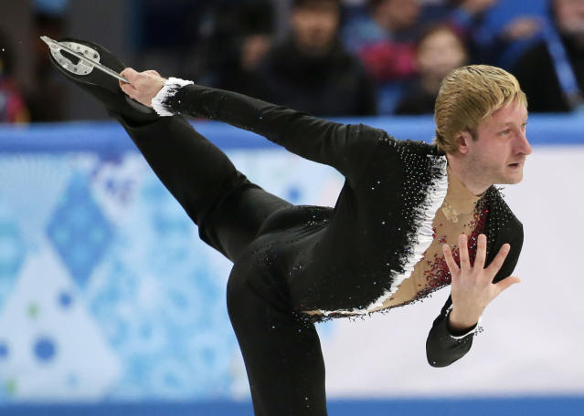 Evgeny Plyushchenko of Russia competes in the men's team short program figure skating competition at the Iceberg Skating Palace during the 2014 Winter Olympics, Thursday, Feb. 6, 2014, in Sochi, Russia. (AP Photo/Bernat Armangue)