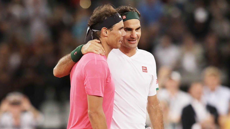 Roger Federer and Rafael Nadal hug after a tennis match at Cape Town Stadium as part of an exhibition game held to support the education of African children, on February 8, 2020 in Cape Town, South Africa.