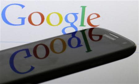 A Google logo is reflected on the screen of a Samsung Galaxy S4 smartphone in this file photo illustration taken in Prague January 31, 2014. REUTERS/David W Cerny/Files
