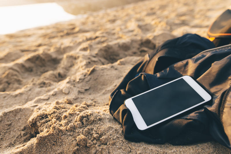 A mobile phone at a beach