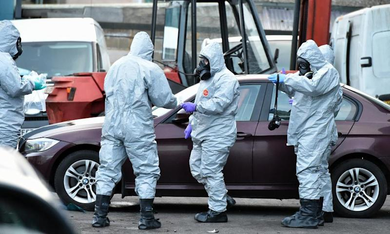 Forensic police officers examine a vehicle believed to belong to the poisoned Russian double agent Sergei Skripal.