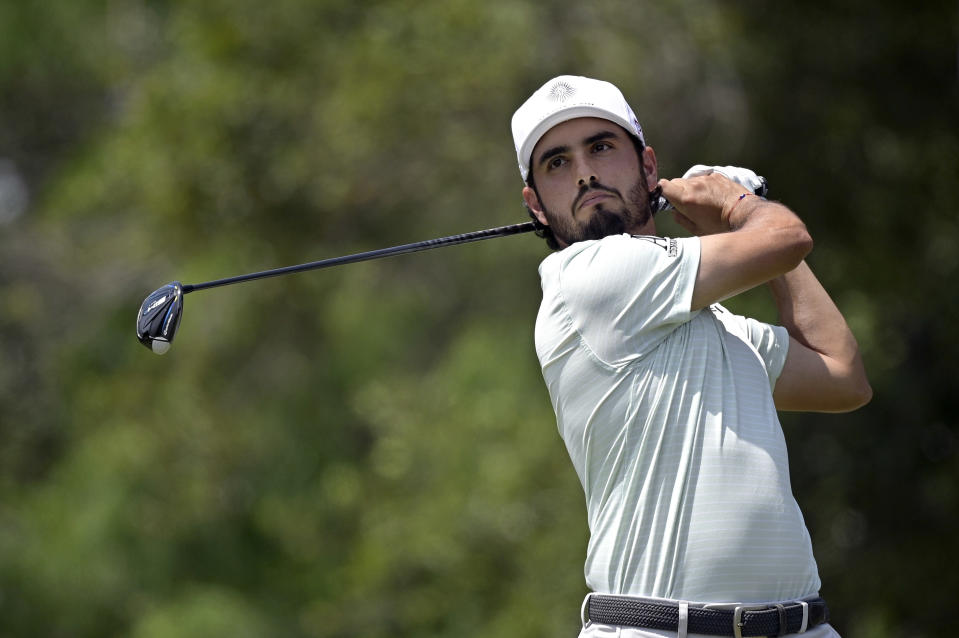 Abraham Ancer, of Mexico, watches his tee shot on the fifth hole during the final round of the Valspar Championship golf tournament, Sunday, May 2, 2021, in Palm Harbor, Fla. (AP Photo/Phelan M. Ebenhack)