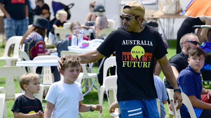 Seen here, Eddie Betts with two of his children.