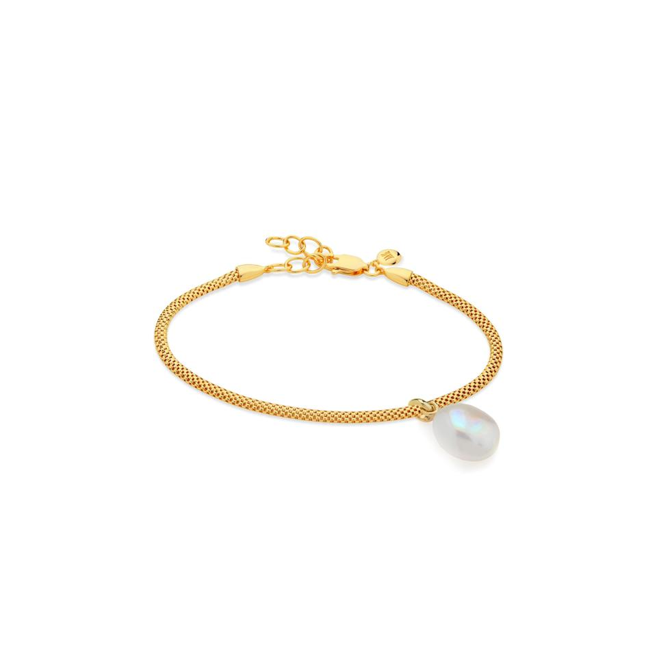 """<a href=""""https://www.glamour.com/story/best-sustainable-jewelry-brands?mbid=synd_yahoo_rss"""" rel=""""nofollow noopener"""" target=""""_blank"""" data-ylk=""""slk:Sustainable jewelry"""" class=""""link rapid-noclick-resp"""">Sustainable jewelry</a> is increasingly more popular, and this eco-friendly bracelet from Monica Vinader (made with influencer <a href=""""https://www.instagram.com/doina/"""" rel=""""nofollow noopener"""" target=""""_blank"""" data-ylk=""""slk:Doina Ciobanu"""" class=""""link rapid-noclick-resp"""">Doina Ciobanu</a>) marks the brand's first step toward using only 100% recycled silver by the end of the year. It's a tiny luxury you can feel good about gifting. $270, Monica Vinader. <a href=""""https://www.monicavinader.com/us/gift-sets/nura-baroque-pearl-and-and-doina-fine-chain-bracelet-gold"""" rel=""""nofollow noopener"""" target=""""_blank"""" data-ylk=""""slk:Get it now!"""" class=""""link rapid-noclick-resp"""">Get it now!</a>"""