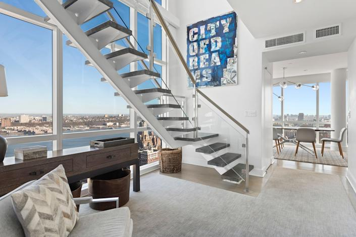 """<p><strong>New York City</strong></p> <p>On the Upper West Side, this duplex penthouse features a floating staircase with black steps and glass sides that overlooks the Hudson River from floor-to-ceiling windows. Other highlights include panoramas of either the city skyline, water, or Central Park from nearly every vantage point, an open-concept family room, large formal living room, eat-in kitchen, and terrace. The building offers attractive amenities such as a movie theater, pet spa, billiards room, 51-foot pool, and outdoor basketball court.</p> <p><strong>Price:</strong> $10.5 million</p> <p><strong>Beds/Baths:</strong> 4 bedrooms, 3.5 baths</p> <p><strong>Square Footage:</strong> 4,000</p> <p>For more information, please click <a href=""""https://streeteasy.com/building/ariel-east/ph"""" rel=""""nofollow noopener"""" target=""""_blank"""" data-ylk=""""slk:here"""" class=""""link rapid-noclick-resp"""">here</a>.</p>"""