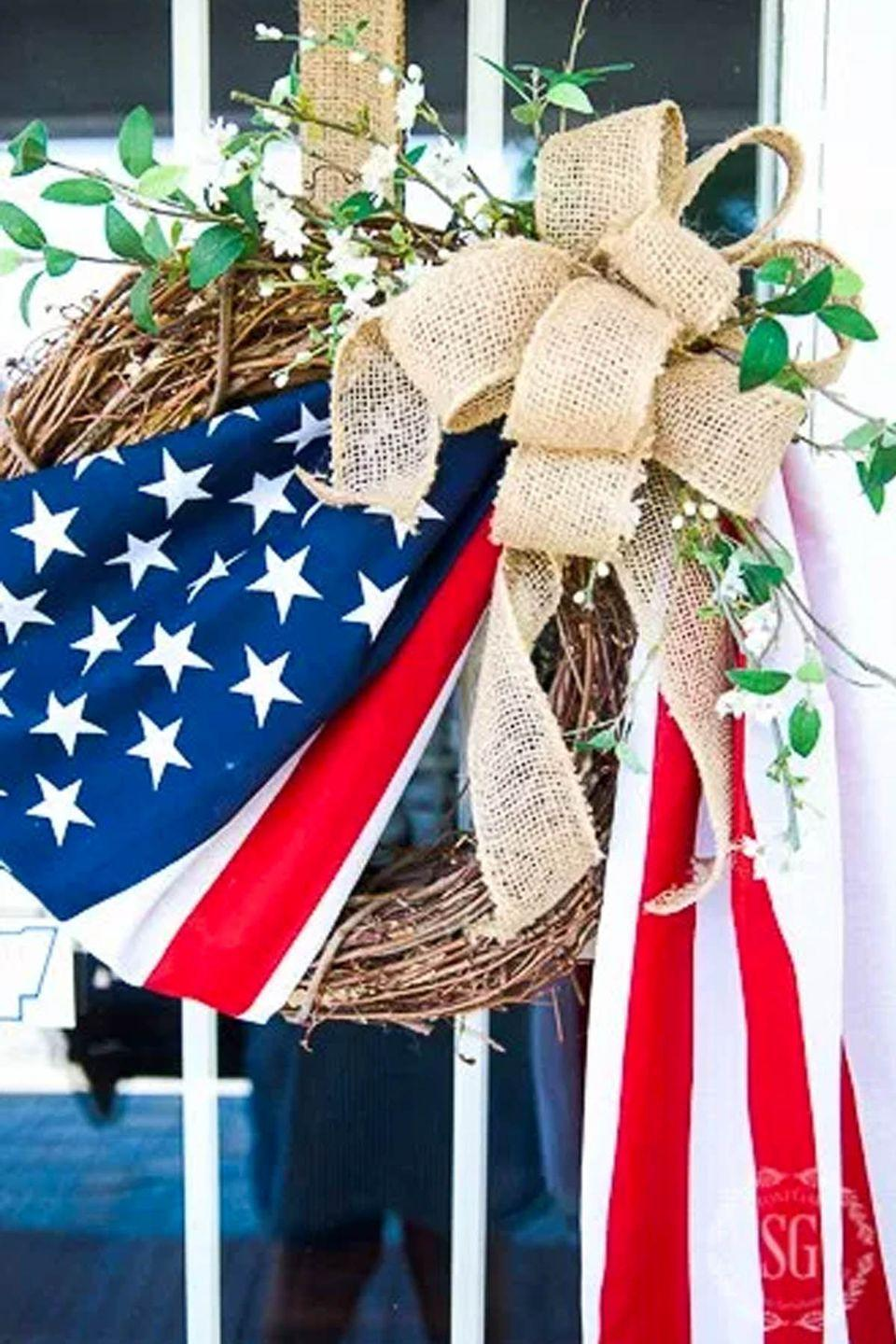 """<p>Display a flag in a creative way by draping it across a grapevine wreath for the ultimate patriotic door decor.<br></p><p><strong>Get the tutorial at <a href=""""http://www.stonegableblog.com/old-glory-wreath-diy/"""" rel=""""nofollow noopener"""" target=""""_blank"""" data-ylk=""""slk:Stone Gable"""" class=""""link rapid-noclick-resp"""">Stone Gable</a>. </strong></p><p><strong><a class=""""link rapid-noclick-resp"""" href=""""https://www.amazon.com/Anley-Fly-Breeze-American-Polyester/dp/B015R4DH2G/ref=sr_1_5?tag=syn-yahoo-20&ascsubtag=%5Bartid%7C10050.g.4464%5Bsrc%7Cyahoo-us"""" rel=""""nofollow noopener"""" target=""""_blank"""" data-ylk=""""slk:SHOP AMERICAN FLAGS"""">SHOP AMERICAN FLAGS</a><br></strong></p>"""