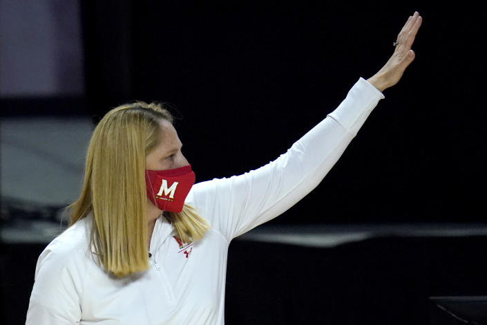 Maryland head coach Brenda Frese gestures toward the Wisconsin bench after an NCAA college basketball game, Thursday, Feb. 4, 2021, in College Park, Md. Frese tied a school record with her 499th win, reaching the milestone by guiding the 10th-ranked Terrapins past Wisconsin 84-48. Frese matched the mark set by Hall of Fame coach Chris Weller, who was at Maryland from 1975-2002. Weller was replaced by Frese, who's 499-130 over 19 seasons. (AP Photo/Julio Cortez)