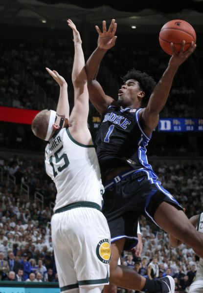 Duke's Vernon Carey Jr., right, puts up a shot against Michigan State's Thomas Kithier during the first half of an NCAA college basketball game Tuesday, Dec. 3, 2019, in East Lansing, Mich. Duke won 87-75. (AP Photo/Al Goldis)
