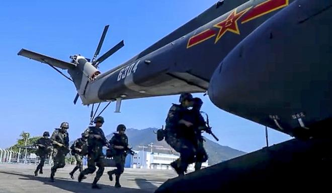 The joint air and sea drill included armed helicopters, infantry, special troops and other combat forces. Photo: Weibo