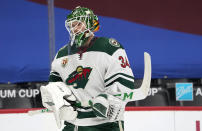 Minnesota Wild goaltender Kaapo Kahkonen skates back to the net after a time out in the first period of an NHL hockey game against the Colorado Avalanche Wednesday, Feb. 24, 2021, in Denver. (AP Photo/David Zalubowski)