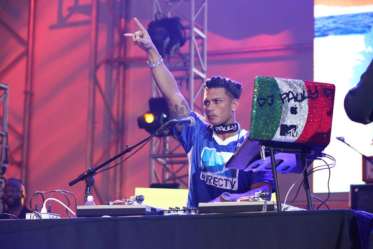 Pauly D spins at the DirecTV Celebrity Beach Bowl in Indianapolis.