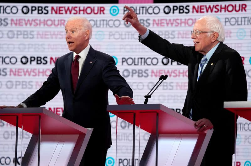 FILE PHOTO: Former Vice President Biden and Senator Sanders speak at the sixth 2020 U.S. Democratic presidential candidates campaign debate at Loyola Marymount University in Los Angeles, California, U.S.