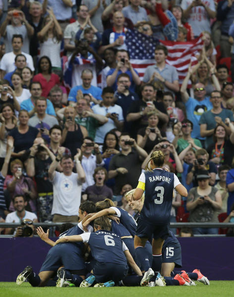 United States players celebrate a goal by Carli Lloyd during the women's gold medal match against Japan at the 2012 Summer Olympics, Thursday, Aug. 9, 2012, in London. (AP Photo/Lefteris Pitarakis)