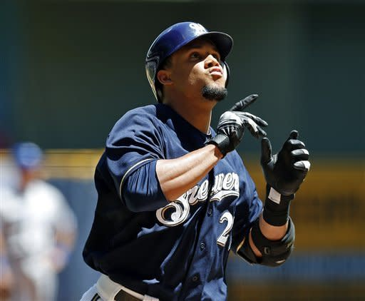 Milwaukee Brewers' Carlos Gomez reacts after hitting a two-run home run off of Toronto Blue Jays' Joel Carreno during the second inning of a baseball game, Wednesday, June 20, 2012, in Milwaukee. (AP Photo/Tom Lynn)