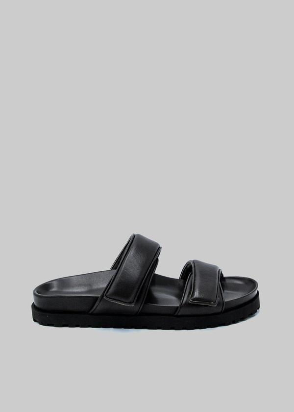 """<p><strong>Gia</strong></p><p>thefrankieshop.com</p><p><strong>$445.00</strong></p><p><a href=""""https://thefrankieshop.com/products/gia-x-pernille-leather-slide-sandals-in-black"""" rel=""""nofollow noopener"""" target=""""_blank"""" data-ylk=""""slk:Shop Now"""" class=""""link rapid-noclick-resp"""">Shop Now</a></p><p>The gift of comfort is always welcome. </p>"""