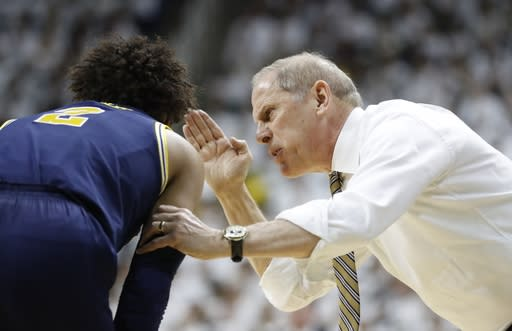 Michigan coach John Beilein talks with guard Jordan Poole during the first half of the team's NCAA college basketball game against Michigan State, Saturday, March 9, 2019, in East Lansing, Mich. (AP Photo/Carlos Osorio)